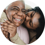 Mother and adult daughter hugging. Happy young and senior women together on sea beach. Concept of tenderness, care, family love, support